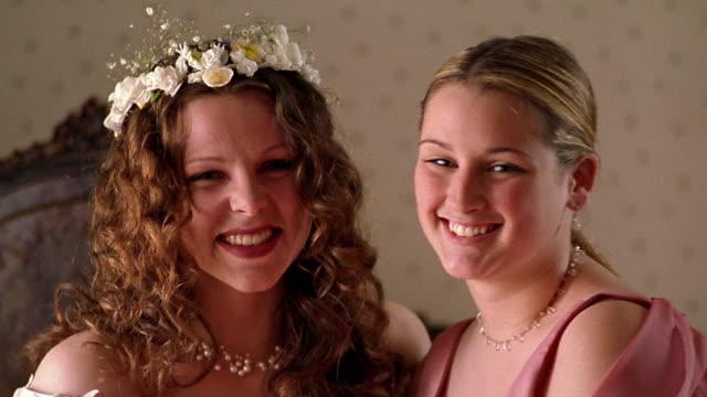 Close up bride and bridesmaid smiling