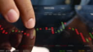 Close up Businessman using Tablet PC analysis stock Market