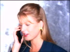 OVEREXPOSED close up businesswoman talking on cellular phone