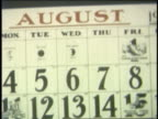 1954 close up calendar pages moving by in fall months
