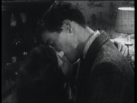B/W 1957 close up couple kissing for a long time then hugging