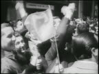 B/W 1955 close up crowd cheering waving flags after overthrowing of Juan Peron / Buenos Aires / newsreel