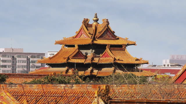 Close up detail of roofs / zoom out rooftops of temples in the Forbidden City / Beijing, China