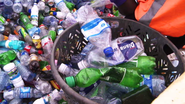 Close up empty plastic bottles and containers at recycling center