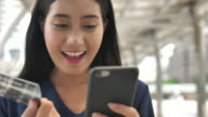 Close up Face of Woman is shopping online using a smartphone