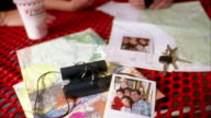 Close up family looking at photos at table outside fast food restaurant
