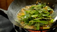 close up : fill Thai basil leaves into food