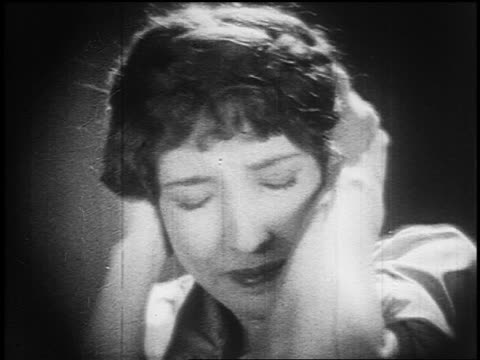 B/W 1925 close up frightened woman (Bessie Love) covering her ears + closing her eyes