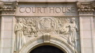 Close up front of Court House with sign and stone carvings / Philadelphia, Pennsylvania