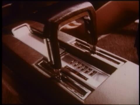1970 close up gear shift in Mercury / man's hand grabs it