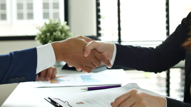 Close up Hand of Business people meeting a job interview in the office and Handshake