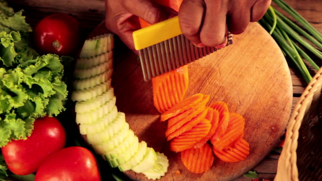 Close up hand of Woman slicing carrots