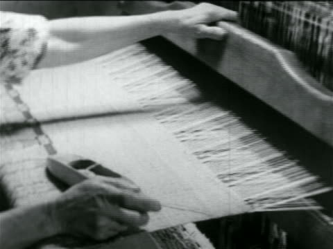 B/W 1934 close up hand of woman using loom in WPA weaving project / documentary