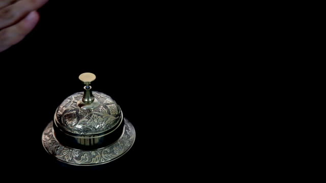 Close Up Hand Ringing Reception Bell