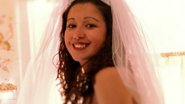 Close up Hispanic bride smiling