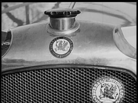 B/W 1928 close up insignia on Vauxhall car / industrial