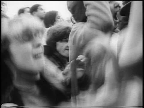 B/W 1965 close up jumping screaming teen girls in crowd / Beatlemania / London / newsreel
