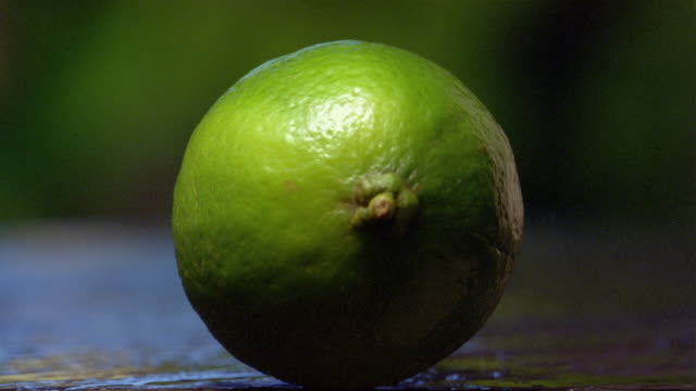 Close up lime being cut in half