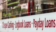 Close Up loan shop signage on shop front window Payday loan stores are to face tougher regulations after moves proposed by the Financial Conduct...