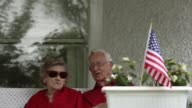 Close up local residents Lowell and Betty Tripp who have been married for 73 years wait for the beginning of the 4th of July Parade at their front...