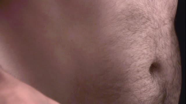 Close Up, Locked Down - Abdomen muscles jiggle / USA