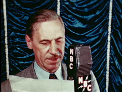 1945 close up man with mustache speaking into NBC radio microphone in studio / industrial