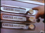 1958 close up man's finger pointing to buttons on coffee vending machine / newsreel