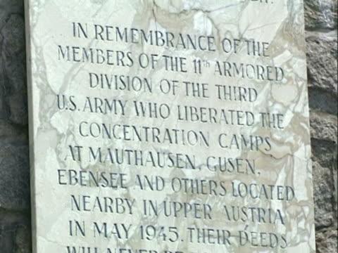 / close up Mauthausen concentration camp marble commemorative plaque
