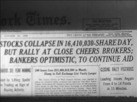 B/W 1929 close up New York Times headline announcing stock market crash / newsreel