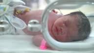 Close up newborn in nursery after childbirth