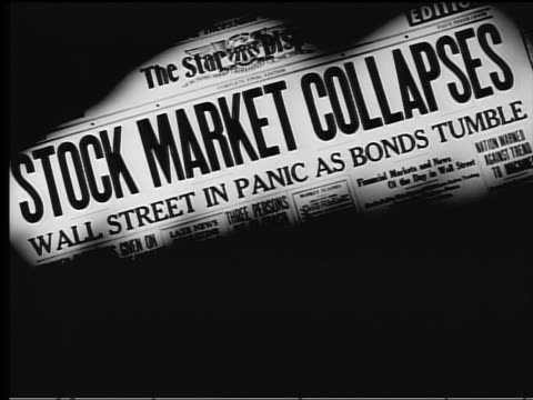 B/W 1929 close up newspaper headline 'STOCK MARKET COLLAPSES / Wall Street in Panic as Bonds Tumble'