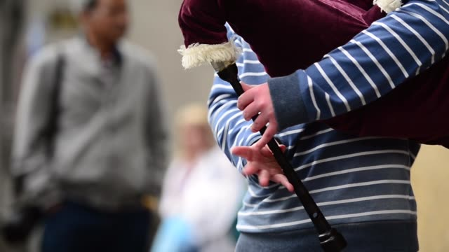 Close Up Of A Boy's Hands As He's Playing Bagpipes Street entertainers perform on Edinburgh's Royal Mile during the city's Festival Fringe on August...