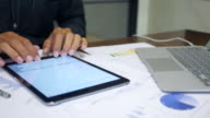 Close up of a man using digital tablet