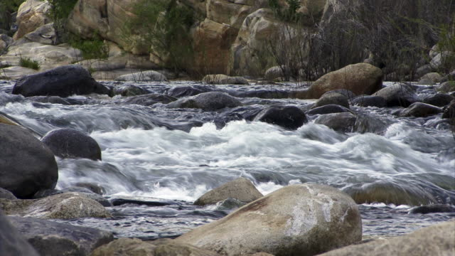 Close up of a mountain stream running over boulders.