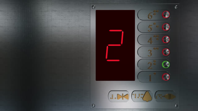 Close up of an elevator control panel going up