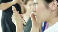 Close Up Of Applying Mascara,beautiful woman applyling mascara