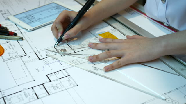 Close up of Architect's hand checking drawing work, 4K(UHD)