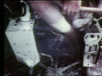 close up of astronaut's legs riding exercise bike