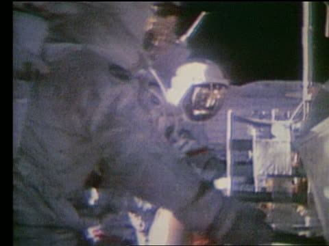 close up of astronauts working on lunar rover on Moon / Apollo 17