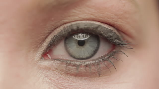 Close up of blue eye of caucasian woman