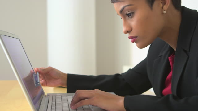 Close up of business woman pointing at laptop screen