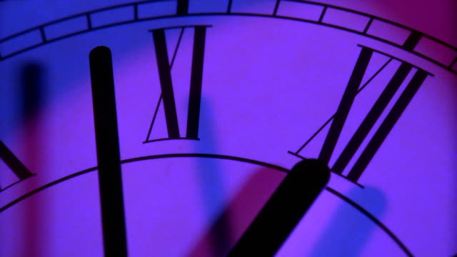 Close up of clock at midnight