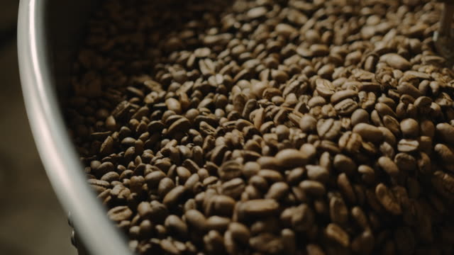 Close up of cooling coffee beans slow motion 4k
