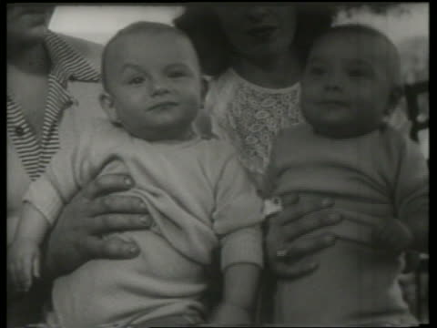 B/W close up of couple holding twin babies / Canadian National Exhibition / SOUND