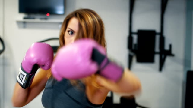 Close up of female boxer working out