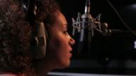Close up of female DJ radio presenter in studio