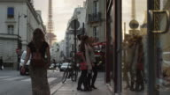 Close up of friends window shopping on city street / Paris, France