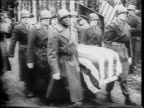 Close up of George S Patton / various angles of soldiers from the 3rd Army carrying Patton's casket in Hamm Luxembourg as others salute and hold...