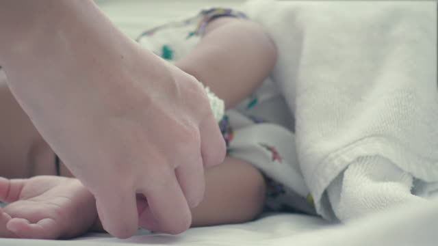 Close up of hand's mother holding hand's son.