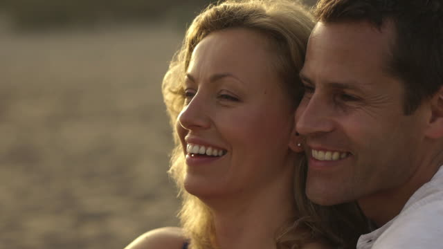 Close up of happy couple embracing on beach/Marbella region, Spain